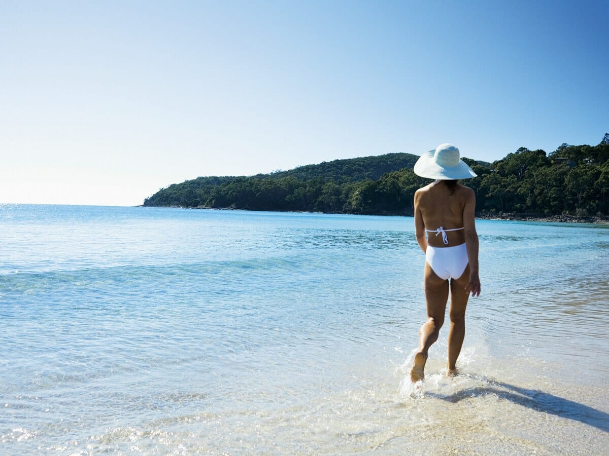 Grand Palais Beachside Resort Gallery Image of woman at the Beach