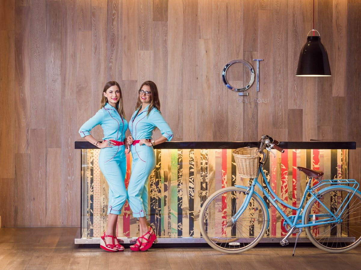 QT Gold Coast Gallery Image of Reception Staff & Resort Bike