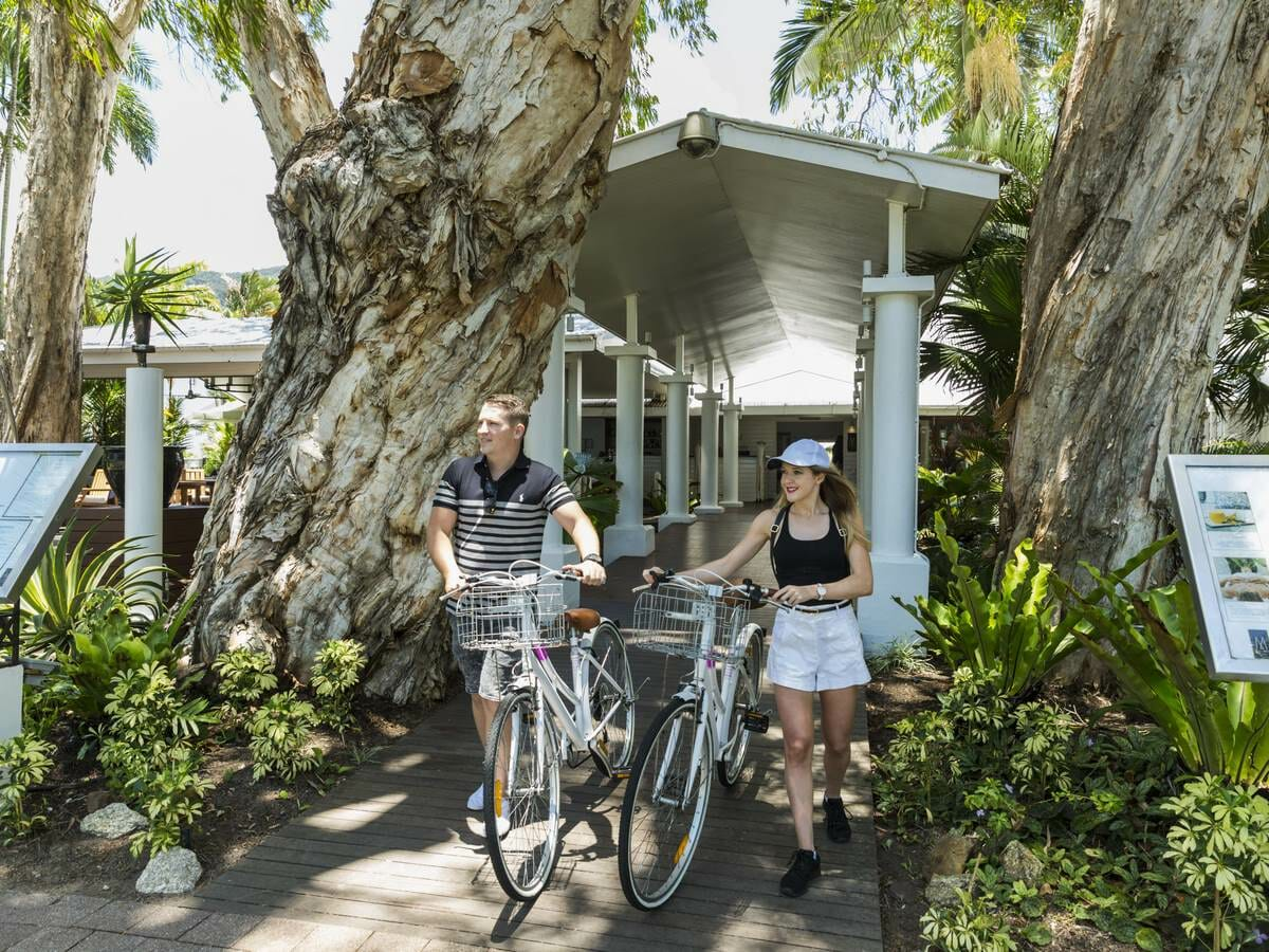 The Reef House Gallery Image of Couple on Bikes