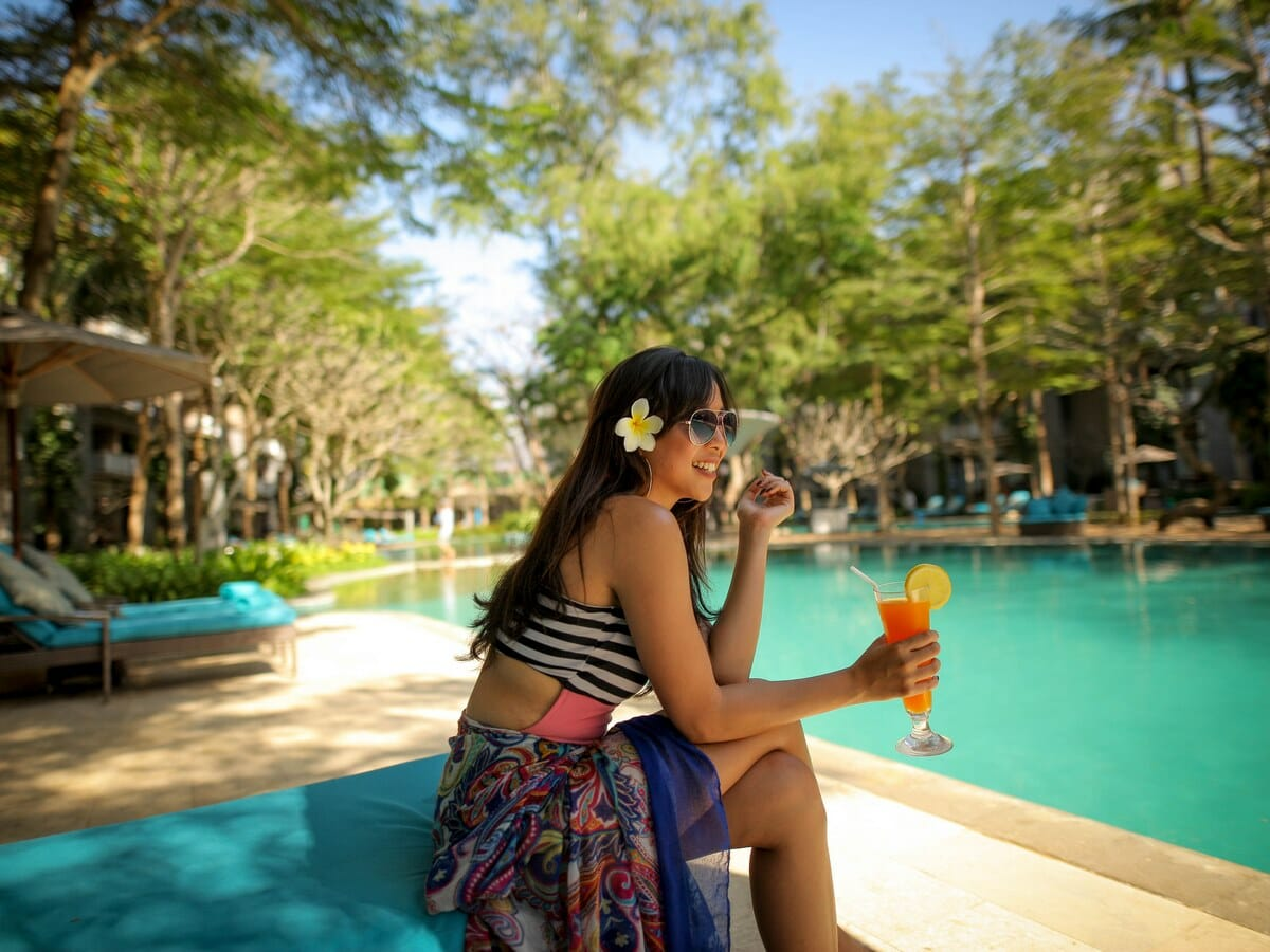 Courtyard by Marriott Bali Nusa Dua Gallery Image of girl drinking cocktails by the pool