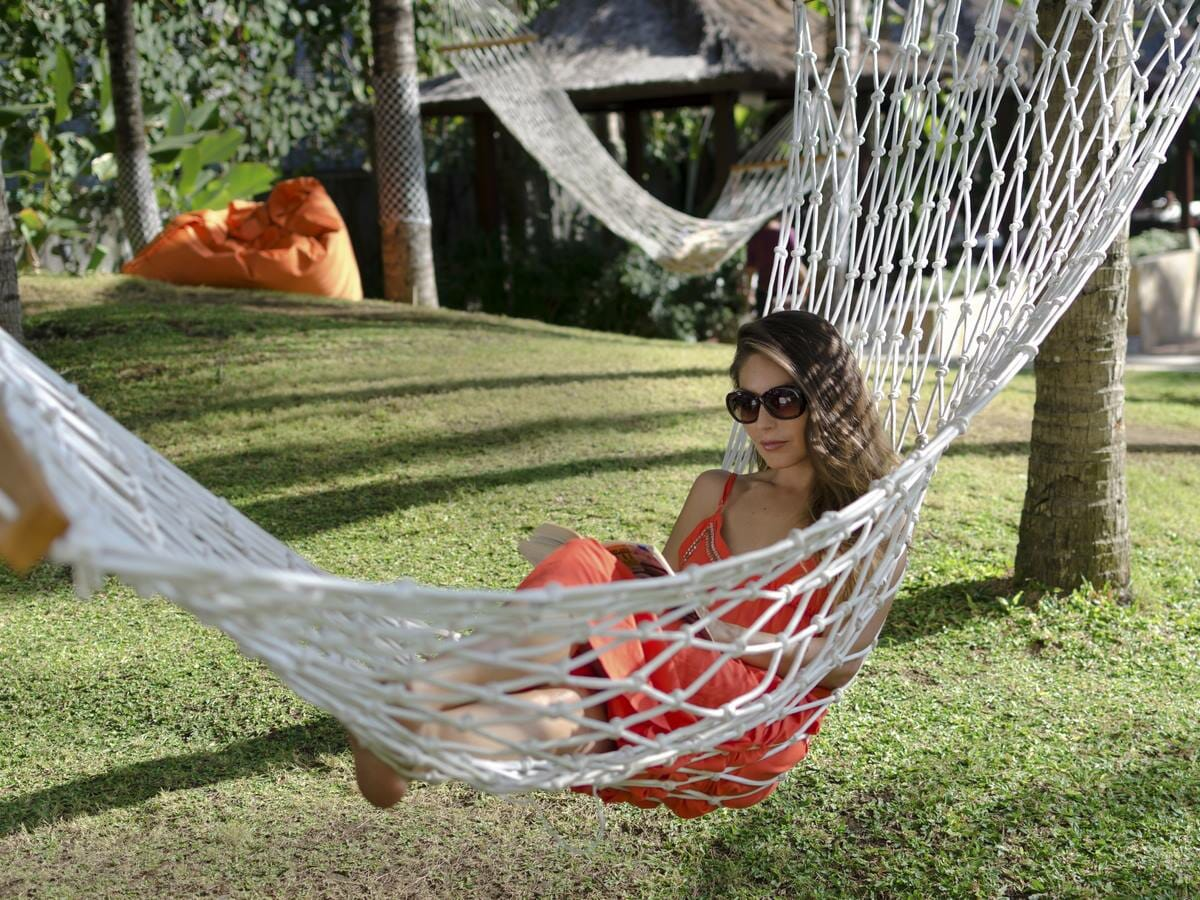 The Stones Legian Bali Gallery Image of Woman on Hammock
