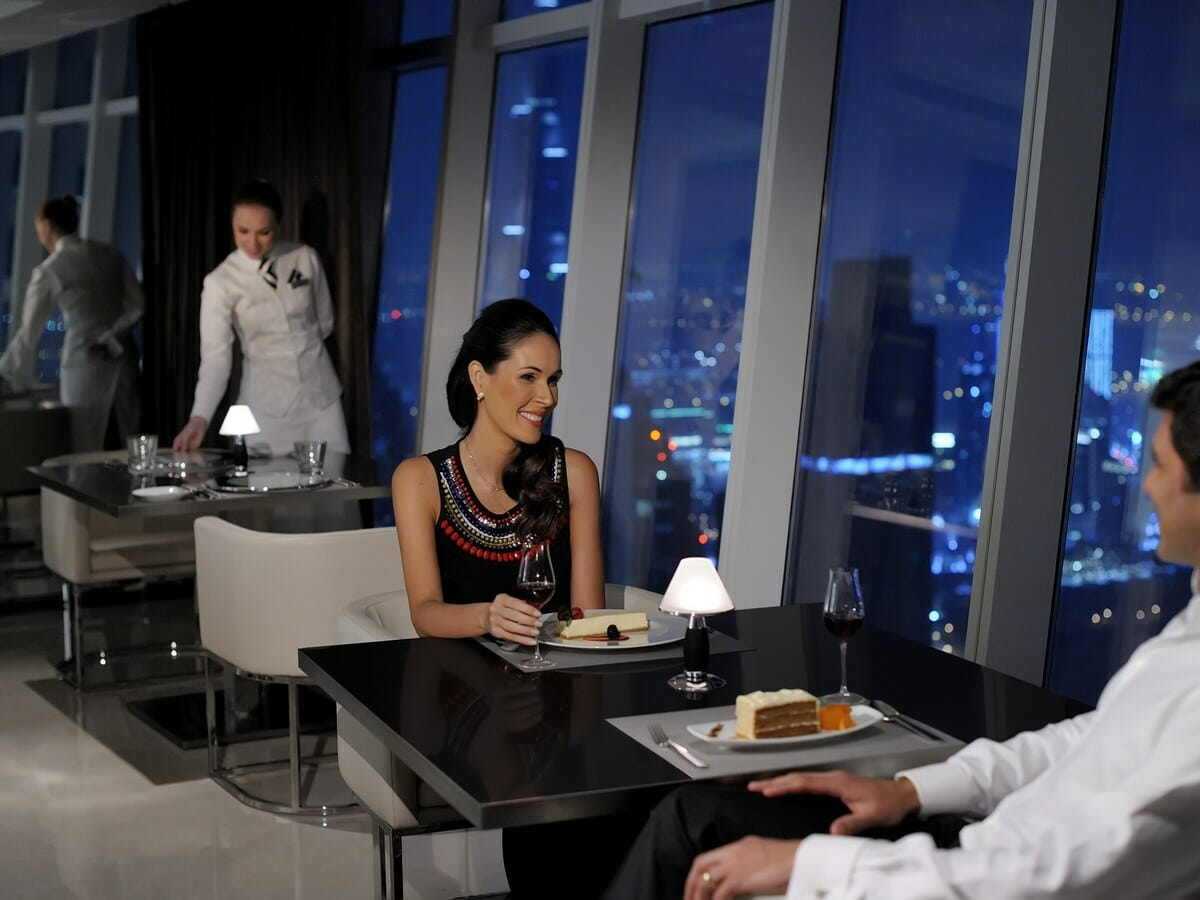 JW Marriott Marquis Dubai Gallery Image of Couple Eating at Prime68 Restaurant
