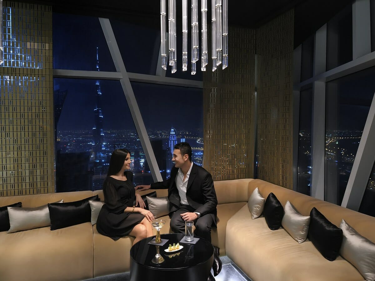 JW Marriott Marquis Dubai Gallery Image of Couple at Seating Area at Vault