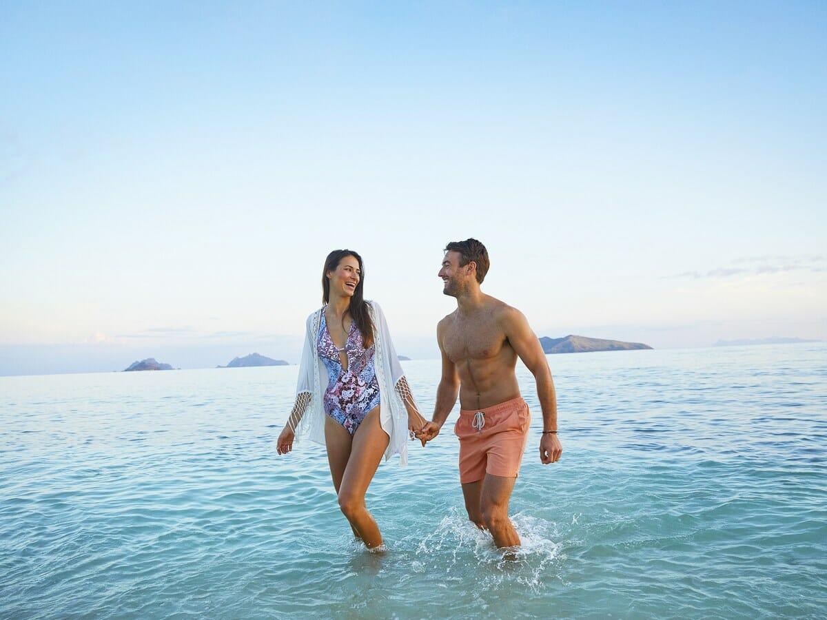 Fiji Hideaway Resort & Spa Vuda Gallery Image of couple walking through water