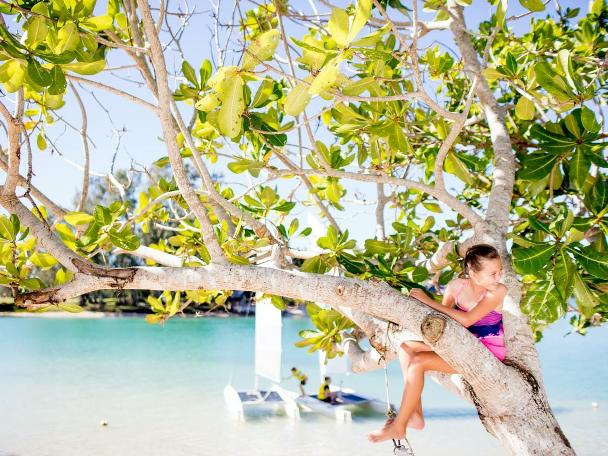 Holiday Inn Resort Vanuatu Gallery Image - Child in tree by the water