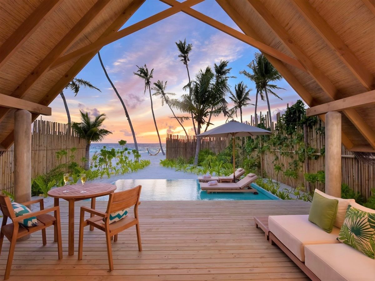 fushifaru maldives Pool Beach Villa Sunset