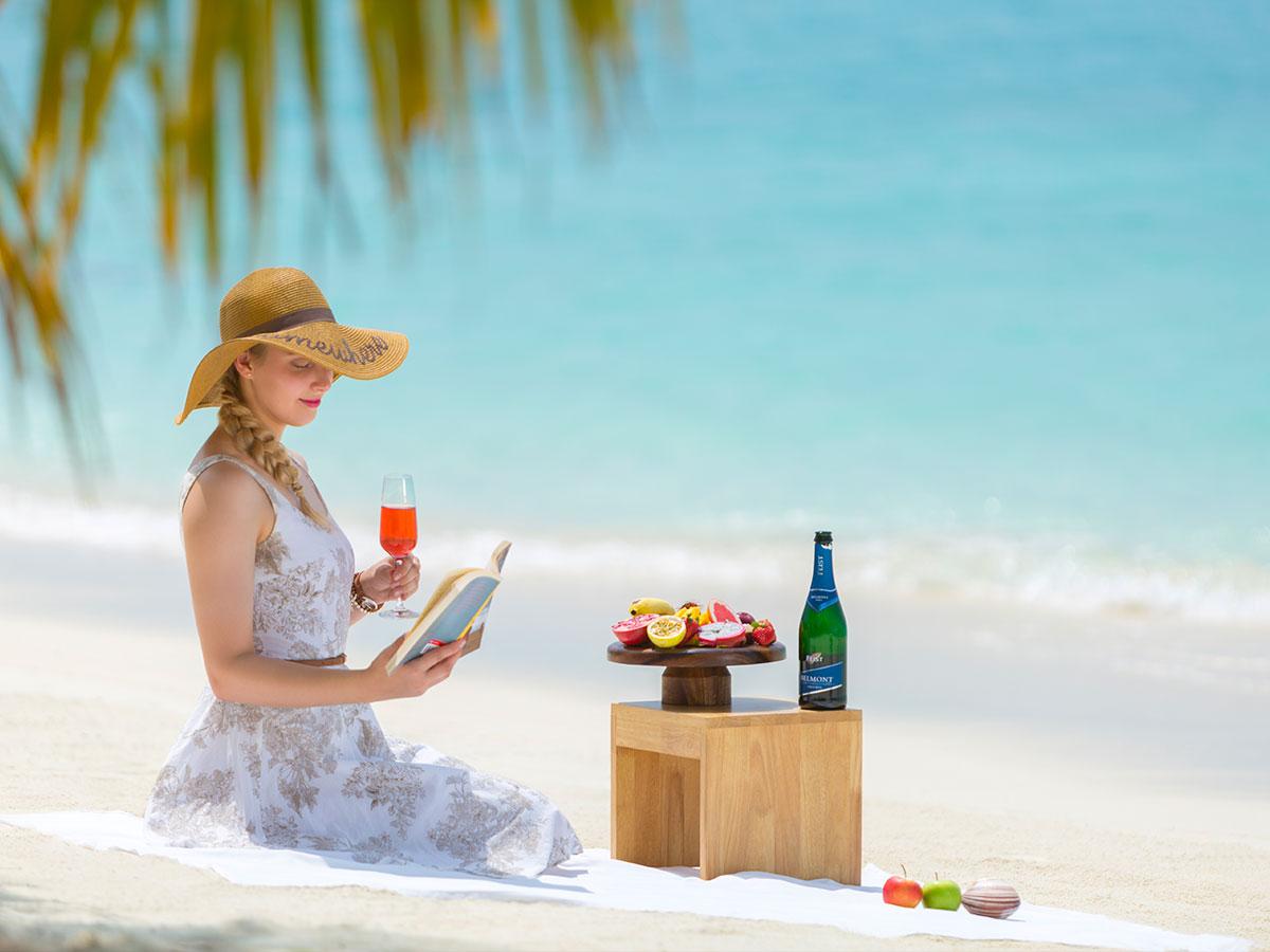 taj-exotica-beach-woman
