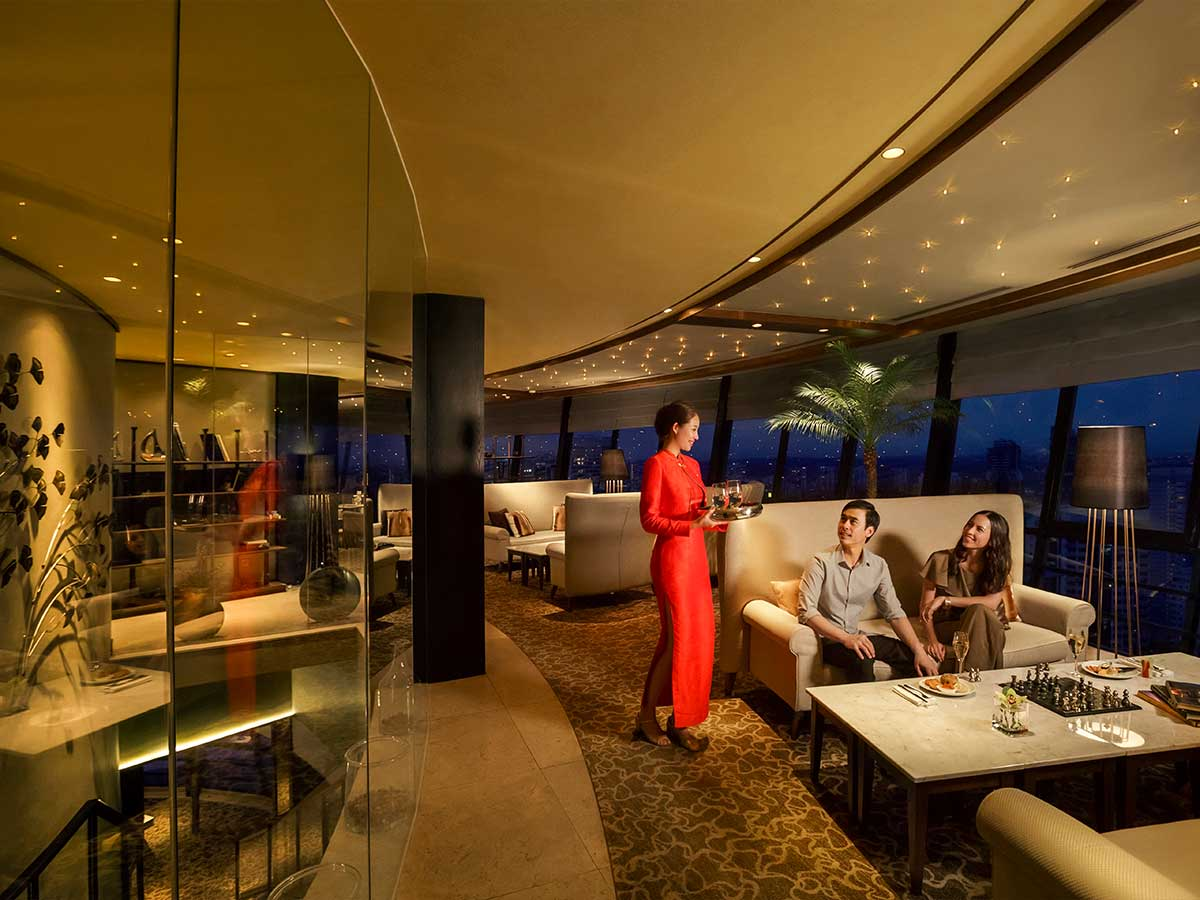 Mandarin Orchard Singapore by Meritus bellboy external superior club lounge