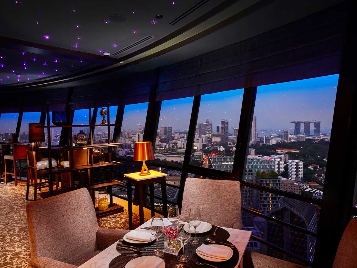 Mandarin Orchard Singapore by Meritus bellboy external superior club lounge with city view