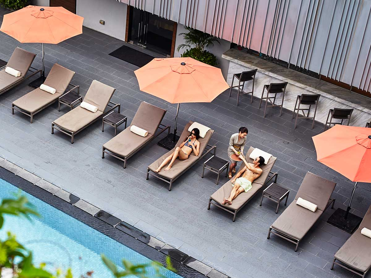 Mandarin Orchard Singapore by Meritus couple by the pool