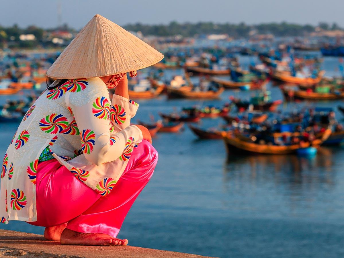 Vietnam local woman watching boats