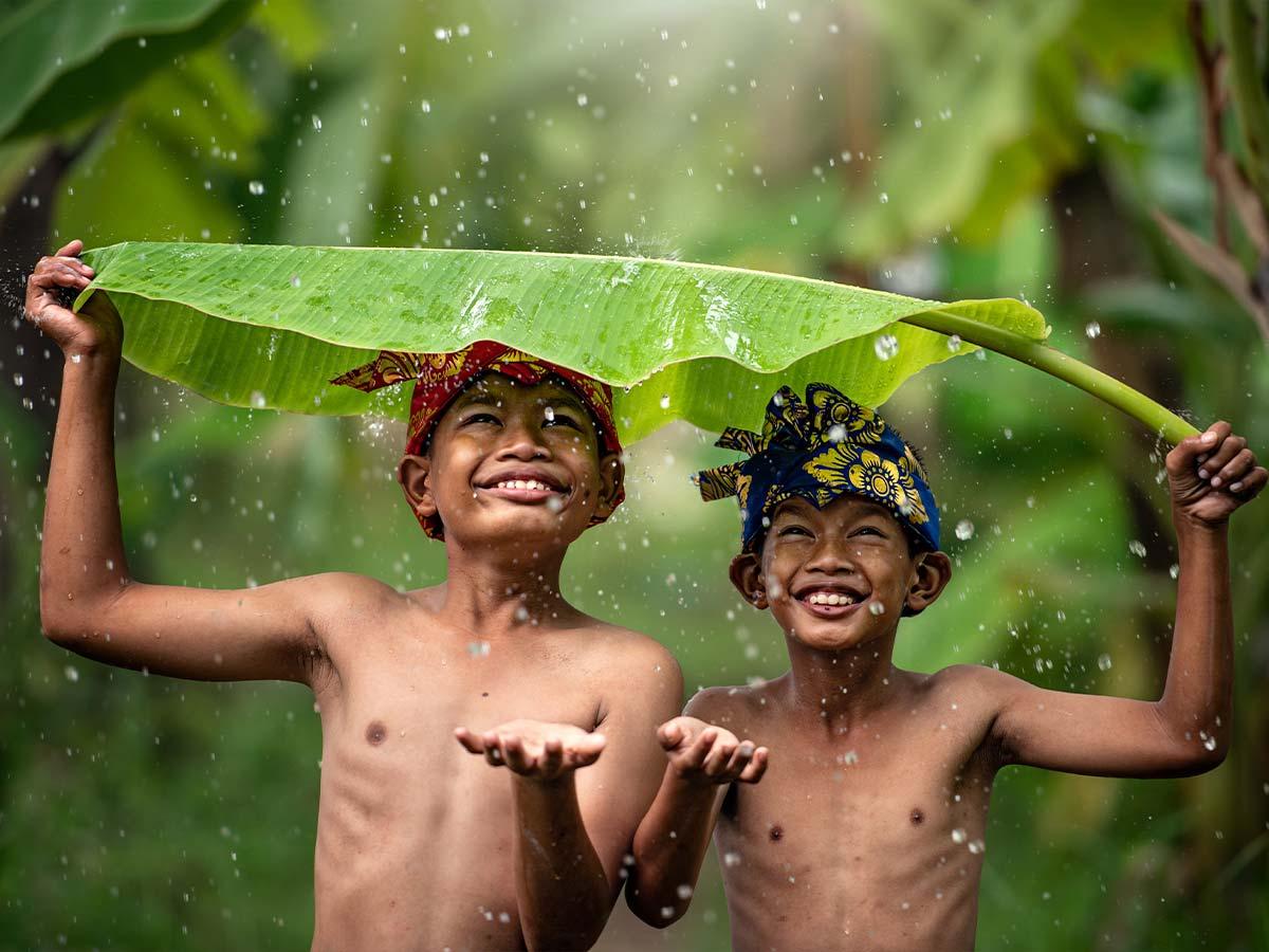 Vietnam local kids in the rain