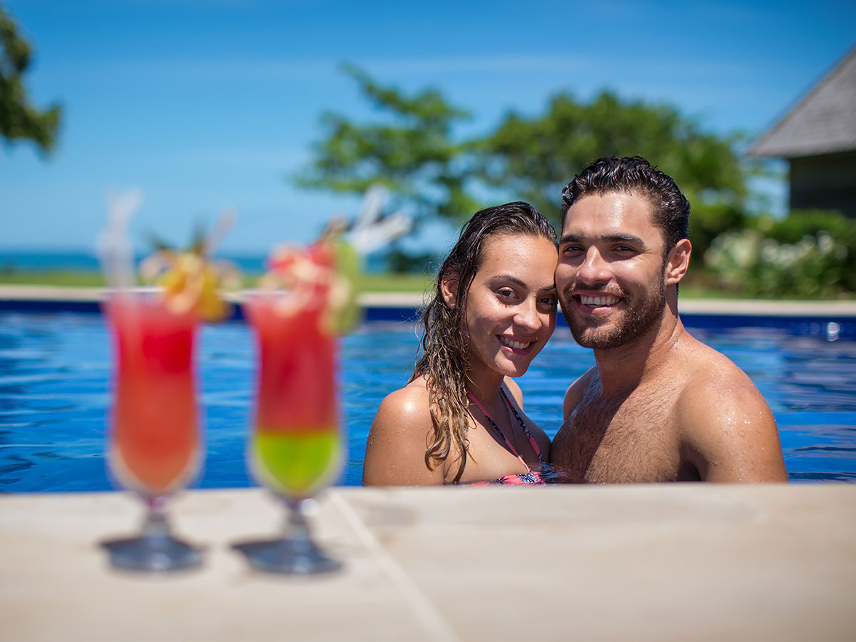 Yatule Resort & Spa couple in the pool with cocktails