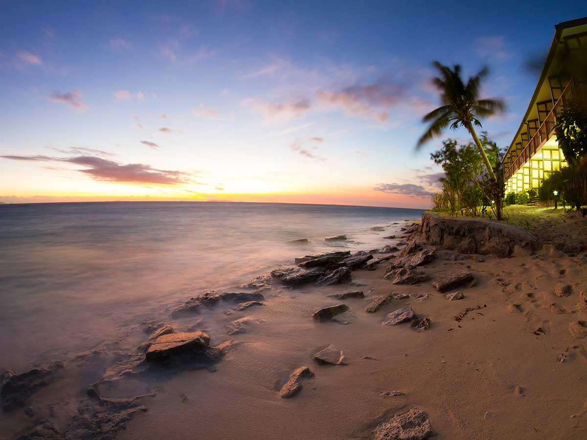 Beachcomber Island Resort Fiji beach hat night